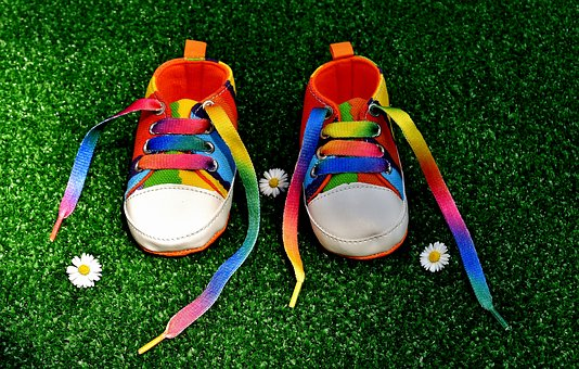 Pair of rainbow coloured shoes with laces